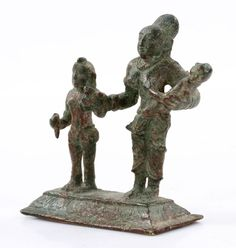 "ndian two figure group, bronze, possibly 15th/16th century, decorated with Shiva and Parvati with Skanda, 3 1/4"" h x 3"" w. Provenance: From a New York private collection."