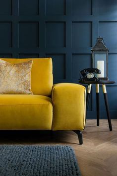 Luxury mustard yellow sofa perfect for dark moody living rooms. Featuring a slim… Luxury mustard yellow sofa perfect for dark moody living rooms. Featuring a slim silhouette and brand new comfort technology, this stunning collect… Living Room Color Schemes, Living Room Designs, Living Room Sofa Design, Yellow Sofa, Blue Yellow Living Room, Navy Sofa, Blue And Yellow Living Room, Yellow Rooms, Yellow Armchair
