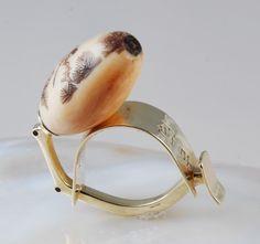 Ring |  Joseph Gatto. 14 kt Gold, scrimshaw ojime bead