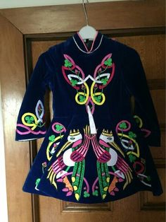 Purple velvet with celtic birds. I like the Book of skills vibe to these birds.  Plus, they sprinkled shamrocks in the design.  With more intricacy, this could work well on a modern dress.