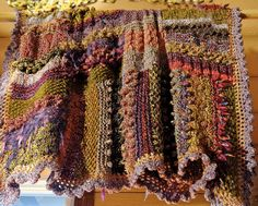 Original pieced, knit afghan by Sandy Miller