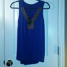 Gorgeous blue embellished tank Bought at local boutique. Beautiful color, perfect for laying all year round. Work or night out wear. Gold beading on front. cupio Tops Tank Tops