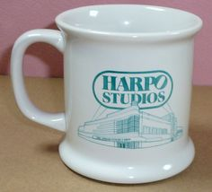 "The Oprah Winfrey TV Show Harpo Studios Aqua Turquoise Teal Logo Coffee Mug Cup  Measures 3 3/4"" tall and 3 3/4"" wide without handle and 5"" wide with handle  Excellent Used Condition: No Cracks, Chips, or Breaks"