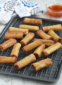 Lumpiang Shanghai with ground chicken, water chestnuts, and green onions. Golden, crunchy and in fun bite-size, these Filipino spring rolls are addictive! Food Network Recipes, Cooking Recipes, Ham Recipes, Turkey Recipes, Lumpia Recipe, Shanghai Food, Appetizer Recipes, Appetizers, Air Fried Food
