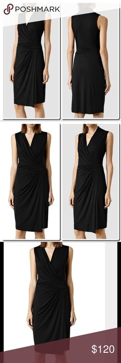 "All Saints Novi Dress in Black All Saints] Novi Dress This gorgeous wrap dress is the perfect LBD. You can dress this piece up with heels or down with a sweater and sneakers. Hook closures secure the inner and outer layers -100% Viscose  Bust 34"".  Waist 26"".  Length 39"" All Saints Dresses"