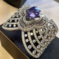 A truly spectacular Blossom bracelet by @louisvuitton Haute Joaillerie collection featuring an impressive mauve sapphire as a centerstone, generously surrounded by round cut and baguette cut diamonds, delicately alternated by round cut diamonds, showcased during Paris Fashion Week.  Stay tuned for more exquisite jewels from PFW. Follow www.realmofjewellery.com Original photo beautifully captured by @carineloeillet #louisvuitton #hautejoaillerie #blossombracelet #mauvesapphire #diamonds…