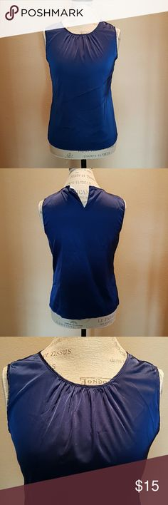 Calvin Kevin Blue Top - S Great to wear to work. Needs to be ironed.  Missing button on the back.  Color must accurate in the last photo.  97% polyester / 3% spandex  Dry clean only Calvin Klein Tops