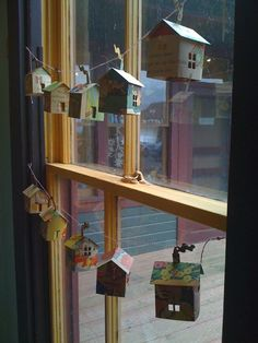 Idea: Paper House Garland - I'd like it on a light string - would need to be able to pack it flat . . .