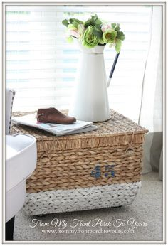 from-my-front-porch-to-yours painted basket with added casters to make a little side table