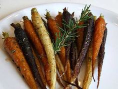 Roasted Whole Carrots with Rosemary and Honey: baby carrots, extra-virgin olive oil, kosher salt, ground black pepper, honey, fresh rosemary