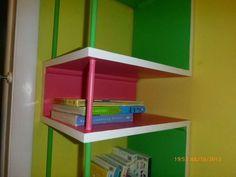 Corner shelf in the nursery for books or toys