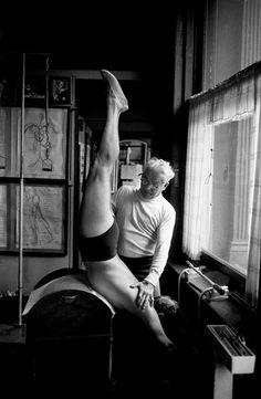 Joe, in his gym, with client on the barrel #pilates
