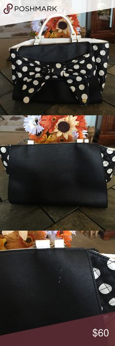 Betsey Johnson Polka Dot Bow Bag EUC Black and Ivory Polka Dot Bow Handbag. Immaculate Condition, extremely clean, used only one time. Only flaws would be 2 scratches  on the leather on the back ( see picture ), and 2 small scuffs inside ( see pic ) Front pocket under the large bow that flips up, snaps closed, inside extremely roomy. Rose design silk fabric inside. No shoulder strap. magnetic closure inside of bag. Size is 9x14. It's such a Fun Bag!! Perfect for the upcoming Fall Weather…