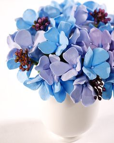 Sure to fool anyone's eye, these breathtaking hydrangea bouquets are  actually created by manipulating pieces of ClayCraft -- air-dried clay  that is soft, durable, and lightweight -- into beautiful flower shapes.