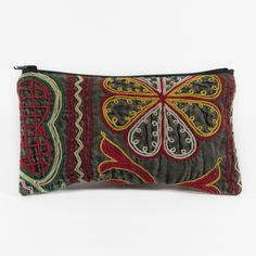 Vintage Recycled Kazakh Clutch. For a good cause... proceeds go towards rehabilitating women who have been rescued from the human trafficking industry.