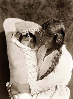 You are viewing an unusual image of an Achomawi Indian Mother and Child. It was taken in 1923 by Edward S. Curtis.    The image shows a touching image of an adoring mother and beautiful child. The woman can be seen happily looking at her small baby.
