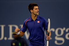 Novak Djokovic (SRB)[2]  reacts after winning the point against Andy Murray (GBR)[3] in the finals of the 2012 US Open - Rob Loud/USTA