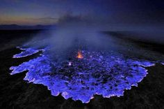 blue-volcano  Dallol volcano – In Ethiopia's Danakil Depression, the sulfur dust in the soil of a hydrothermal vent ignites to form blue flames.