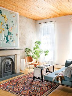 simple, plaster walls, wood plank ceilings, tied sheer curtains