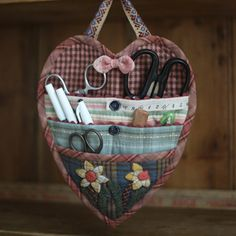 Heart shaped holder for sewing supplies