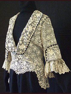 Edwardian handmade Irish crochet lace jacket with satin trim and it looks like maybe bobbin lace ruffles on the sleeves. 1910. Photo: Vintage Textile.