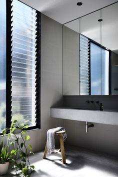 Modern black house located in Melbourne, Australia, designed in 2018 by Ola Studio. Home, House Design, Bathroom Interior, Louvre Windows, White Houses, Louver Windows, Design Milk, Studio, Bathroom Design