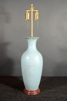 Marvin Alexander,Inc. Ceramic turquoise colored vase mounted as a lamp with a stippled sangue de bouef color, China 19th century.