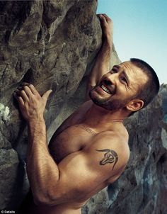 Is there anything manlier than scaling a mountain with a tattoo, facial hair and no shirt? No, there is not.