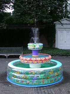 very cute. (:Title: Paddling Pool Fountain  Year: 2003  Materials: inflatable paddling pools, buckets, water pump, 3-head spray head, PVC, wood, tarp, glue, paint  Dimensions: L 234 cm W 234 cm H 280 cm