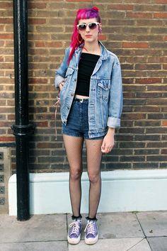 Black top + denim shorts + denim jacket + fishnet tights + trainers