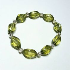 Only $6.69! - SALE Glorious Olive Green Crystal Clear Twisted Oval Beaded Stretch Bracelet w/White Silver Ribbon Textured Ball Bead Spacers FREE USA SHIPPING https://www.etsy.com/listing/248304783/sale-glorious-olive-green-crystal-clear