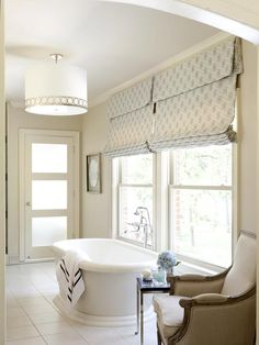 Airy white bathroom. Design by Tobi Fairley. Photography by Nancy Nolan. #laylagrayce #bathroom