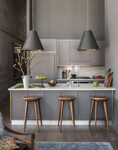 Kitchen breakfast bar with a moody intimate scheme