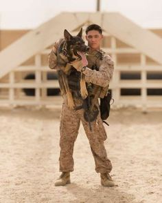 Lance Cpl. James Nemger, a dog handler assigned to 3rd Battalion, 6th Marine Regiment, poses with hi... - Sgt. Matthew Callahan/US Marine Corps