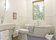 The open window is unusual for a bathroom. It gives you enough view outside while savoring your bath in the tub.