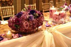 The Old Mill Inn and Spa Toronto, Wedding Decorations head table decor purple hydrangea purple roses lisianthus wedding centerpiece