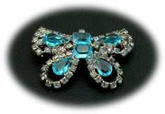 Vintage Unsigned Costume Jewelry Aqua butterfly pin with Swarovski alexandrite chatons  http://www.grannysjewelrybox.com/si2238.shtml