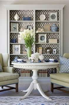 DC Design House - French white pedestal table flanked by yellow wingback chairs, Oushak Rug, Stronheim Cranston lattice fabric in Granite li...