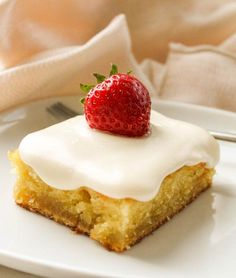 The Food Charlatan // I love this almond sheet cake. It is so moist and amazing. The frosting is the best part.