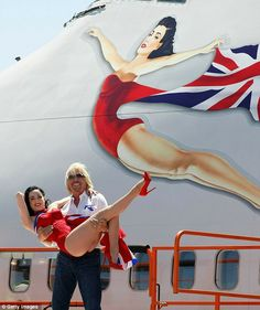 Dita - immortalised on the side of the aircraft as Branson's flying lady    Read more: http://www.dailymail.co.uk/travel/article-1287023/Dita-Von-Teese-Richard-Branson-wing-walk-Las-Vegas.html#ixzz1iyoZ4lLw