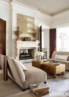 Sofas in a Pollack fabric, Donghia; pillows in a Fabricut fabric; ottomans, Christopher Maier; cowhide, Lovelace Interiors; art, Jean Geraci.
