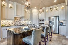A lighted upper row of cabinets is a distinctive touch. See why these new homes by J. Houston Homes in Waxahachie, Texas are featured on www.NewHomeSource.TV.