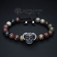 Warrior Helmet Bracelet, Mens Bracelet This handmade bracelet features 8mm Picture Jasper Beads and Bronze Warrior Helmet charm. Its adjustable, utilizing a sliding knot made with macrame cord and is easy to put on and take off by yourself. Length: Men`s Size : 7- 8.5 (18 cm -21 cm) Women`s Size: 6-7.5 (16 cm -19 cm) ★★★All bracelet models can be customized as stretch or adjustable for the same price. You may have a piece created just for you. Please send message for custom orders....