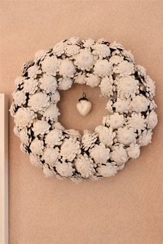Love this wreath! Made from the BOTTOM of the pinecones! Looks kinda like snowflake flowers!