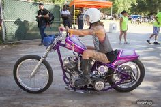 Yuriko riding her pink and purple Shovelhead chopper out of Born Free 6.