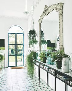 House tour: a London family home that uses greenery in every room - Vogue Living Bert And May Tiles, Hallway Lighting, House Lighting, Interior Lighting, Minimalist Apartment, Vogue Living, Modern Light Fixtures, Entry Foyer, Entryway Decor
