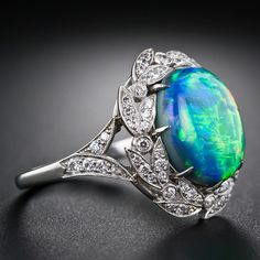 Gem Fire Opal and Diamond Ring | From a unique collection of vintage cocktail rings at http://www.1stdibs.com/jewelry/rings/cocktail-rings/