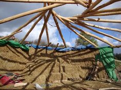 Reciprocal frame and straw bale house.  Lammas