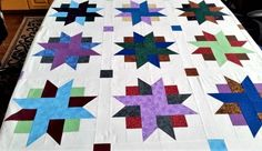 Last month, I showed you these beautiful ribbon-star quilts and explained how I made the stars. Now let me show you how I finished the quilts. First, I laid out all 18 stars so I could decide which...