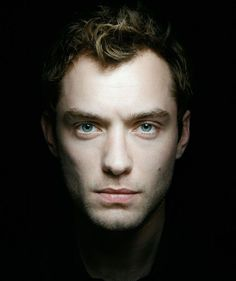 Jude Law  by Annie Leibovitz low key spotlight portrait